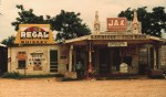 A_cross_roads_store_bar_juke_joint_and_gas_station_in_Melrose_Louisiana_1944